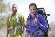 Portrait of mature female and her boyfriend hiking, Sedona, Arizona, USA - ISF15509