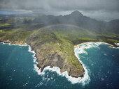 USA, Hawaii, Kauai, rainbow over Na Pali Coast, aerial view - CVF00919