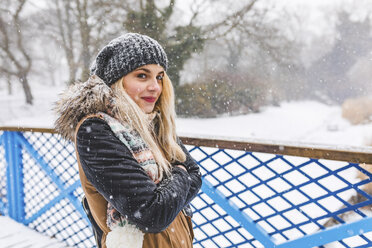 Portrait of smiling teenage girl on snowy day - WPEF00586