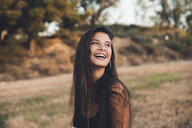 Portrait of laughing teenage girl in nature - ACPF00068