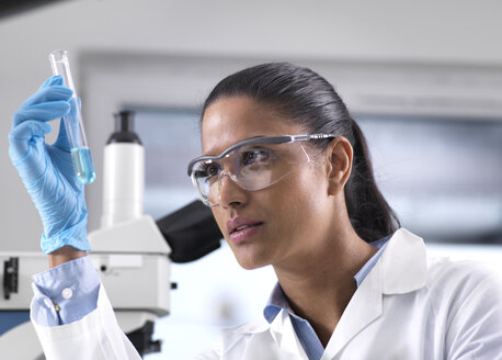 Biotechnology Research, female scientist mixing a chemical formula - ABRF00167