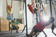People working out in gym - CUF38781