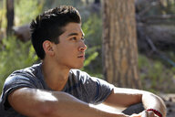 Portrait of young man in forest, Los Angeles, California, USA - ISF15875