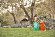 Two brothers having a sack race, County Park, Los Angeles, California, USA - ISF15965