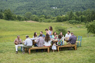 Family having meal together and socialising, outdoors - ISF16076