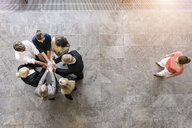 Overhead view of business team in circle with hands together - ISF16157