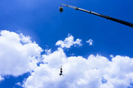 Greece, Crete, Bungee Jumping, man jumping bungee in front of clouds - BEF00178