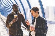 Two businessmen with coffee to go and smartphone - WPEF00607