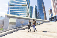 Russia, Moscow, two businessmen with coffee to go in the city - WPEF00610