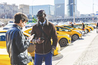 Russia, Moscow, two businessmen with smartphones in the city - WPEF00613