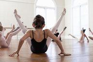 Children sitting on floor practicing ballet in ballet school - ISF16410