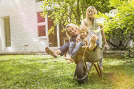 Three generation of women having fun with wheelbarrow - CUF39115