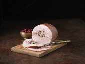 Christmas dinner. British Wiltshire ham with orange and cranberry stuffing and cranberries - CUF39314
