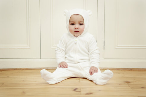 Baby sitting wearing bear babygro - CUF39371
