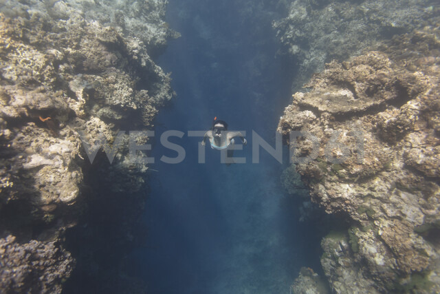 Indonesia, Bali, young woman snorkeling - KNTF01134