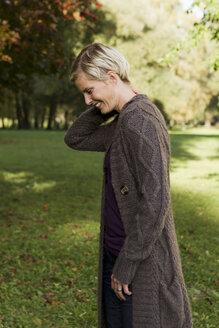 Woman walking in park - CUF39626