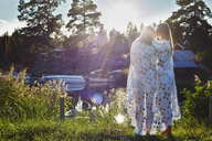 Two young adult female friends wrapped in blanket, Gavle, Sweden - CUF39870