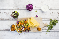 Tacos with mixed salad, sweet patato Falafel, carrot, red cabbage, yoghurt sauce, parsley and black sesame - LVF07228