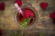 Glass bottle of homemade raspberry lemonade flavoured with rosemary - LVF07237