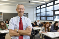 Portrait of mature male teacher in classroom - CUF40084