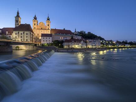 Austria, Upper Austria, Steyr, River Enns and St Michael's Church at blue hour - EJWF00901