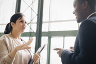 Businesswoman sharing ideas with male coworker in meeting at office - MASF08409
