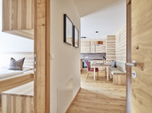 Interior of open plan kitchen and bedroom of a holiday home - CVF00968