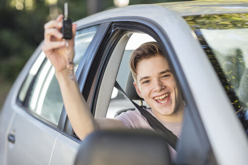 Happy learner driver cheering and holding car key - ZEF15797