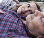 Affectionate couple in love lying outdoors - UUF14537