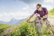 Father and daughter looking at plants, Tyrol, Austria - CUF40423