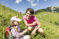 Mother and daughter discovering plants, Tyrol, Austria - CUF40426