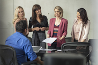Confident businesswomen on a meeting in conference room - ZEF15811