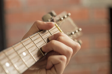 Close-up of man's hand playing guitar - ZEF15823