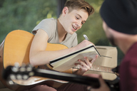 Musician teaching student how to play guitar - ZEF15835