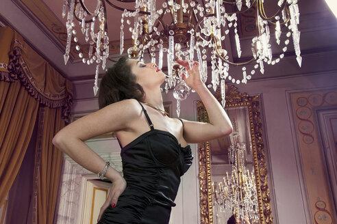 Woman in lingerie under chandelier - CUF40861
