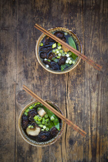 Two bowls of Japanese miso soup with sugar peas, shitake mushrooms, tofu and mung sprouts - LVF07272
