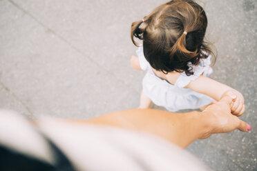 Toddler girl walking holding mother's hand - GEMF02117