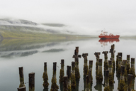Abandoned pier with ferry on lake, Reydarfjordur, Iceland - CUF41050