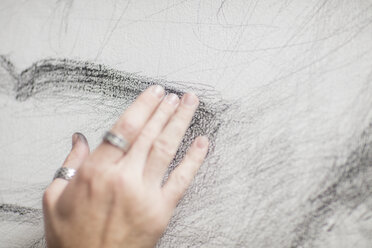 Artist's hand touching drawing - ZEF15843
