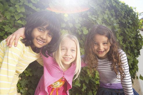 Portrait of three girls in garden - CUF41469