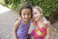 Portrait of two girls hugging - CUF41481