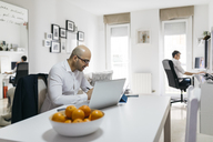 Two men working in home office - JRFF01685