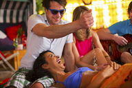 Group of friends having fun at indoor beach party - CUF41518