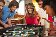 Friends playing table football - CUF41521