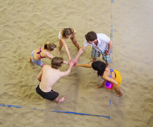 Aerial view of friends team talk at indoor beach volleyball - CUF41527