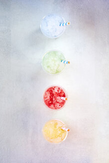 Row of plastic cups with various fruit slushes - BZF00417