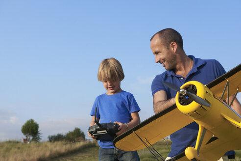 Father and son preparing model plane - CUF41663