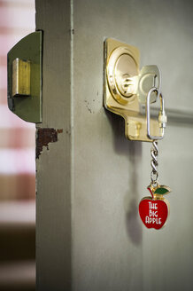 Open front door with key and souvenir keyring - CUF41760