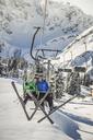 Couple riding ski lift, Warth, Vorarlberg, Austria - CUF42159
