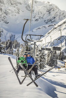 Couple riding ski lift, Warth, Vorarlberg, Austria - CUF42159